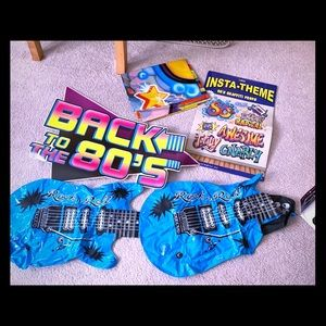 1980s party decor: blow up guitars and wall decor